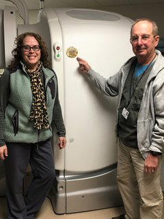 Melissa Dettore (left) and Zenon Bursztynsky (right), Nuclear Medicine Technologists at OSF Saint Elizabeth Medical Center, celebrating the ACR Accreditation in Nuclear Medicine.