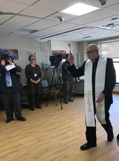 Father Emmett Norden conducting the blessing of the newly renovated oncology clinic.