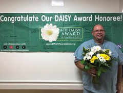 Don Zimmerman, RN accepts the DAISY Award