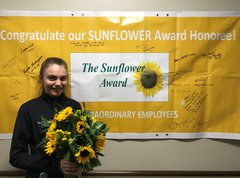 Sydney Donaldson, OB Tech accepts the Sunflower Award
